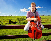 young caucasian cello player with rural background